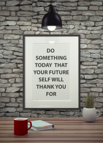 Inspirational quote on picture frame over a dirty brick wall. DO SOMETHING TODAY THAT YOUR FUTURE SELF WILL THANK YOU FOR.